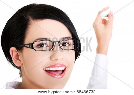 Portrait of woman in eyewear writing something.