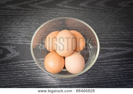 Group Of Brown Eggs On Wooden Background