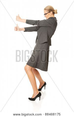 Determined businesswoman pulling a stick