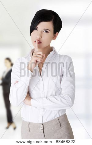 Beautiful business woman gesturing silent.