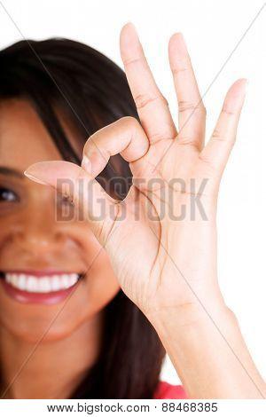 Close up beautiful mulato woman gesturing ok