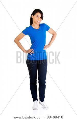 Full length woman posing with hands on hip.