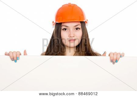 Woman Builder In A Helmet With A Blank Banner.