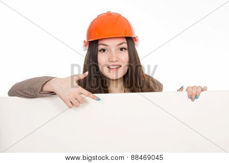 Girl Builder In Helmet Showing A Finger On A Blank Banner