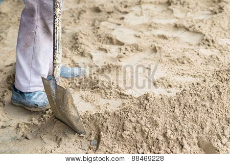 Man Digging In The Ground With Shovel And Spade