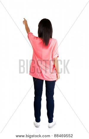 Back view of a woman pointing up.