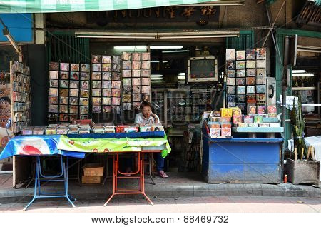 Vendor Sells Cd And Movie On The Street In Chinatown, Bangkok