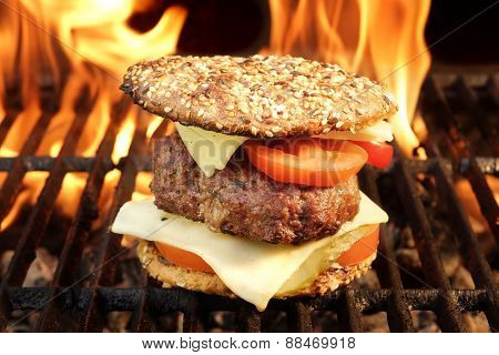 Homemade BBQ Beef Burger On The Hot Flaming Grill.