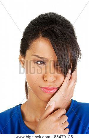 Young woman suffering from toothache.