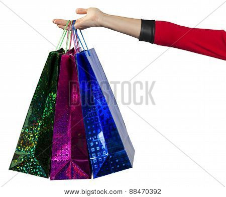 Young woman handing the colorful shopping bags