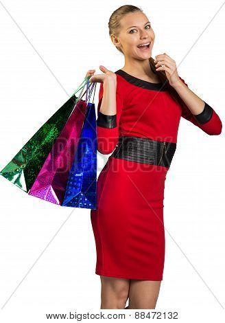 Laughing woman handing bags