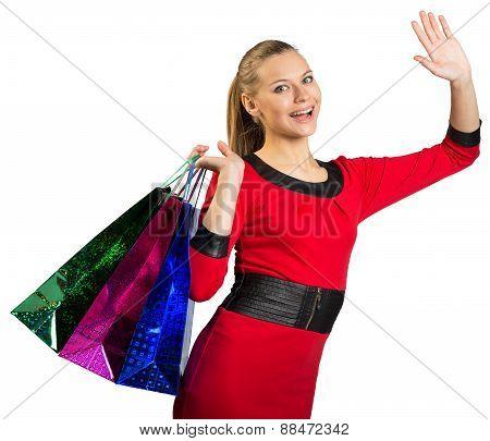 Laughing woman waving hand