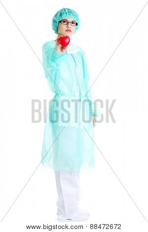 Full length female doctor holding heart model.