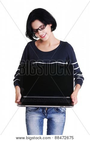 Student woman showing her laptop.