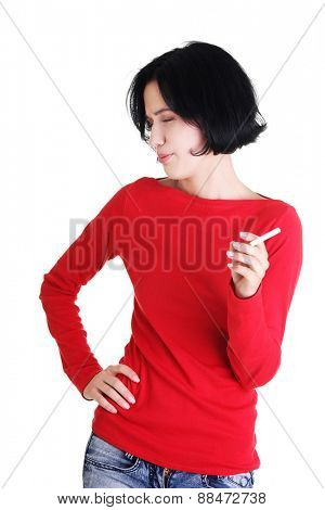 Young addicted woman smoking cigarette.