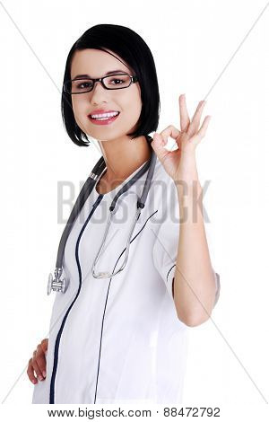 Female doctor showing OK sign.