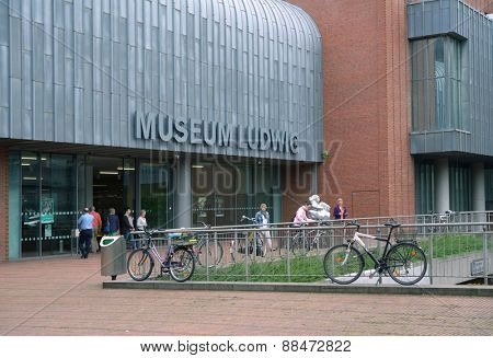 COLOGNE, GERMANY - JUNE 30, 2013: People in front of the Museum Ludwig. Emerged in 1976 after the chocolate magnate Peter Ludwig endowed 350 modern artworks, it houses a large collection of modern art