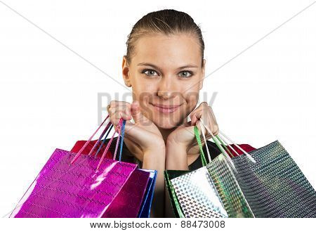 Woman with smile handing bags. Closed up