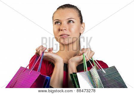 Sad lady handing bags narrowing her eyes