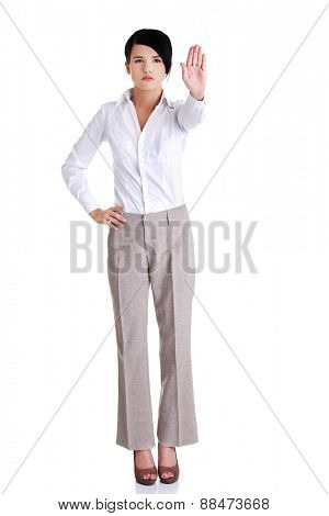Full length of a woman showing stop sign.