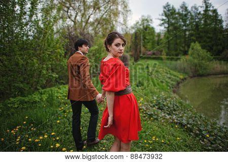 Young Beautiful Couple Near The Lake