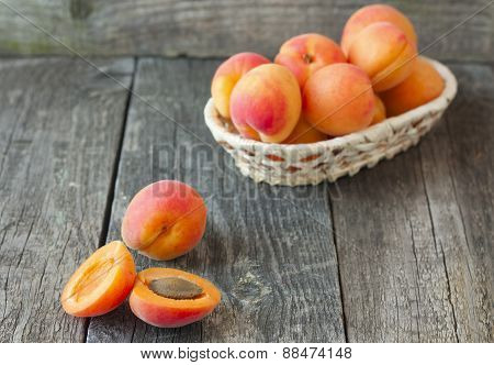 Apricots In A Basket On A Wooden Background Horizontal