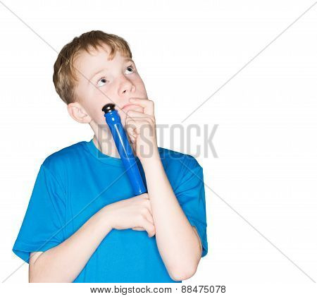 child with a pen in hand