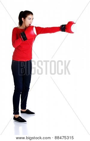 Full length young woman with boxing gloves.