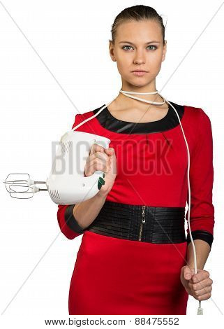 Young woman holding mixer and pull cord
