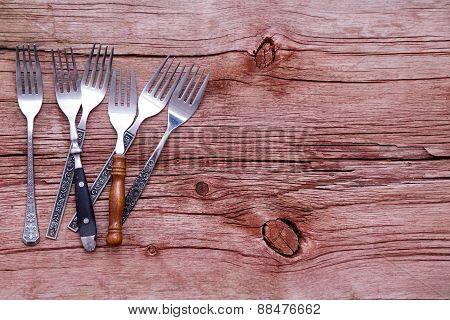 Rustic Forks On A Rustic Wooden Table
