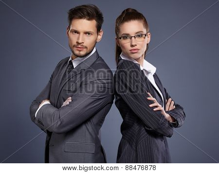 A couple of managers in suits on the blue background