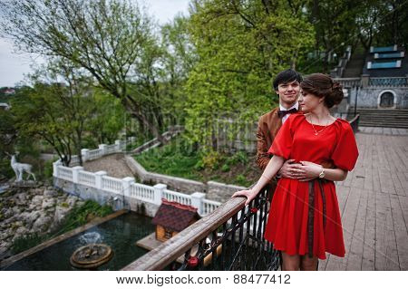 Young Beautiful Couple At The Bridge