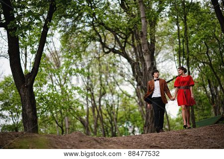 Young Beautiful Couple In The Forest