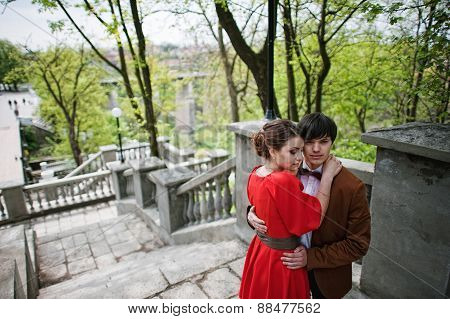 Young Beautiful Couple At The Stairs