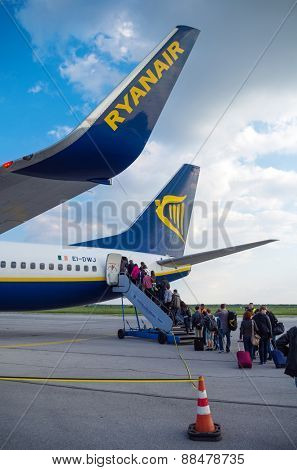 LONDON, UNITED KINGDOM - April 12, 2015: Passengers boarding a Ryanair Boeing B737 in Stansted airport near London, UK