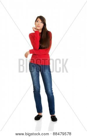 Beautiful casual young thoughtful student woman.