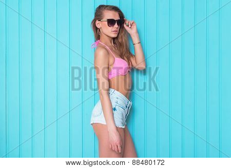 summer portrait of young stylish fashion glamor sexy brunette woman or girl posed in sunny day jeans
