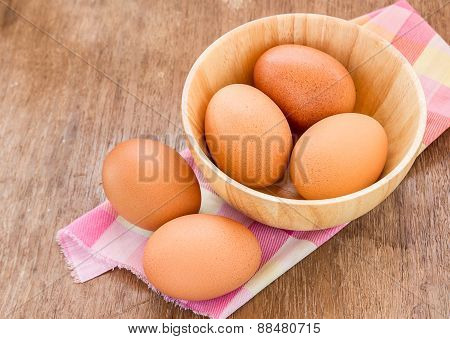 Eggs In A Wooden Bowl On The Table