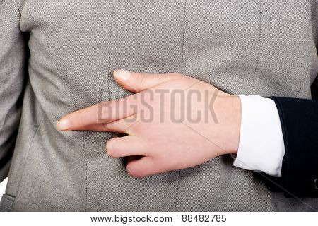 Businesswoman fake fingers crossed while embracing.