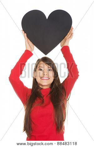 Young student woman with heart made from paper.