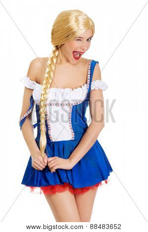 Oktoberfest woman in Bavarian dress blinks eye.