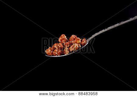 Closeup Of Sugar Peanuts On A Black Background