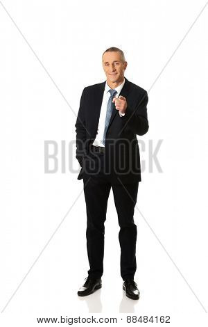 Full length businessman pointing on you.