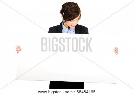 Beautiful smiling call center woman with empty banner.