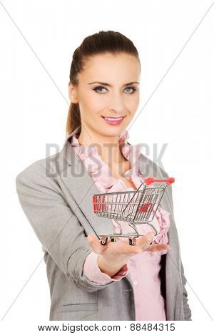 Beautiful businesswoman with shopping cart.