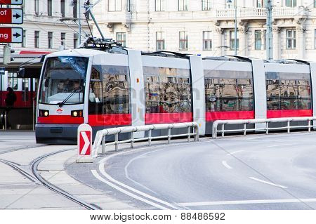 Modern red tram in Vienna Austria.