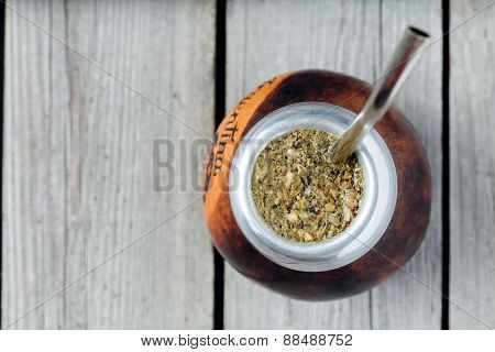 Healthy yerba mate tea  kalabash with bombilla in rustic style