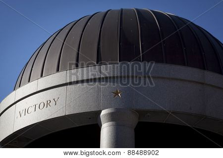 TRENTON, NJ - APR 4 2015: The word Victory etched in granite on the dome of the New Jersey World War II Memorial rotunda located in Trenton across from the State House capitol building.