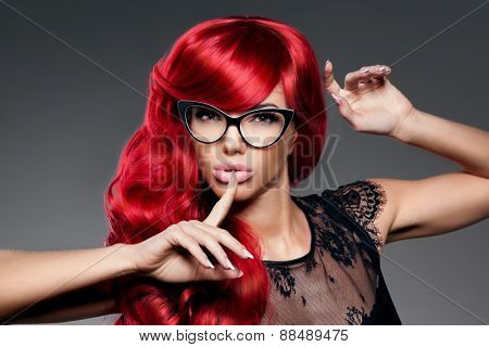 Luxury fashion trendy  young  woman with red curled hair in glasses. Optics. Girl with beauty hairstyle. Model with long stylish  bangs, wave, curly hair. Lady with a beauty face. Secret, gossip, news