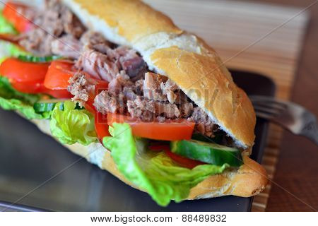 Tuna Baguette With Vegetables On The Brown Plate